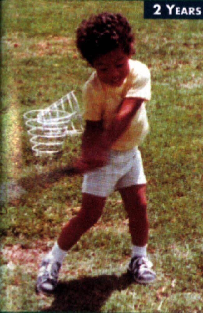 A two-year-old Tiger Woods swinging a golf club.