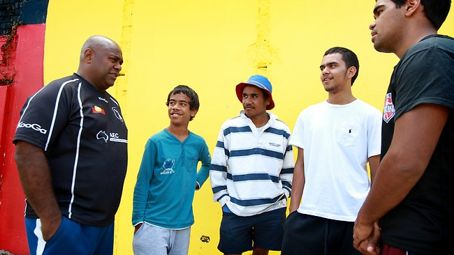 Shane Phillips talks with three youth in Redfern. Picture: Cameron Richardson