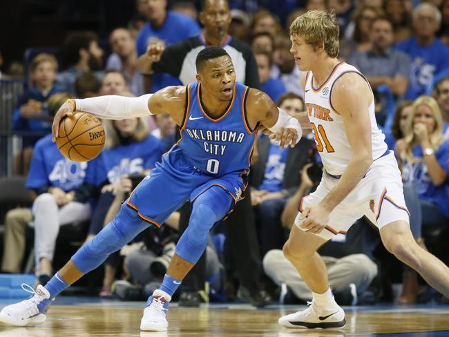 Oklahoma City Thunder guard Russell Westbrook drives against New York Knicks guard Ron Baker. (AP Photo/Sue Ogrocki)