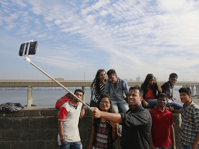 Group photo ... a group takes a selfie on Mumbai's coastline. Picture: AP Photo/Rafiq Maqbool