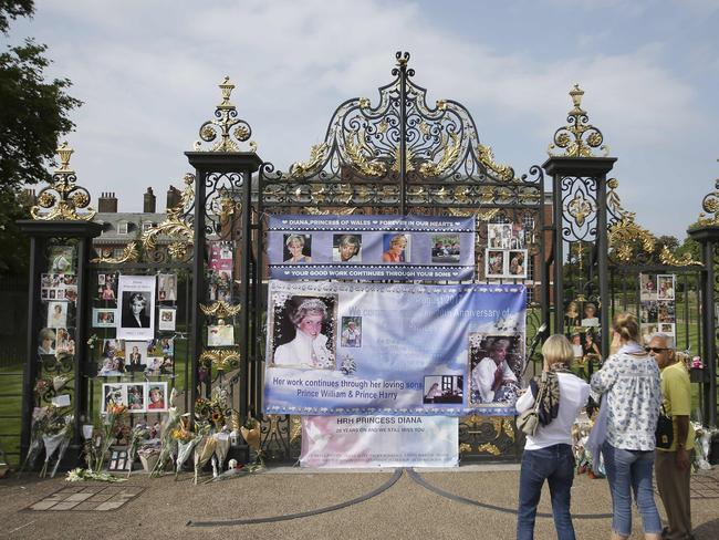 Photographs of Diana, Princess of Wales, and floral tributes left outside Kensington Palace in Central London ahead of the 20th anniversary of her death. Picture: AFP