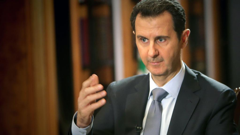 This file photo taken on January 18, 2014 shows Syrian President Bashar al-Assad during an interview with AFP in Damascus. Picture: AFP.