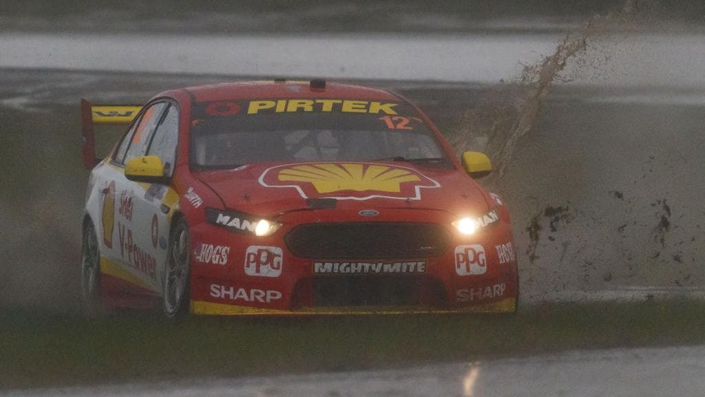 Fabian Coulthard find the grass during practice. Picture: Mark Horsburgh