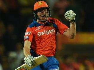 Gujarat Lions James Faulkner celebrates after scoring the winning runs during the 2016 Indian Premier League(IPL) Twenty20 cricket match between Rising Pune Supergiants and Gujarat Lions at The Maharashtra Cricket Association Stadium in Pune on April 29, 2016. / AFP PHOTO / INDRANIL MUKHERJEE
