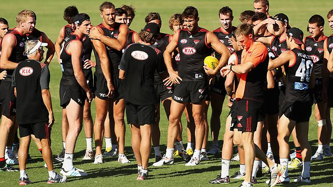 Coach James Hird (back on) instructs the team as a group during an Essendon training session at Tullamarine last week. Picture: Hamish Blair