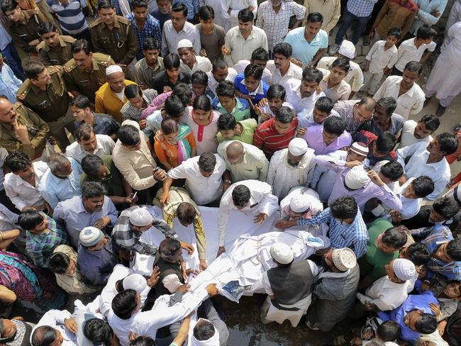 Mourners carry the body of an Indian girl who was raped and set on fire during her funeral in New Delhi this week.