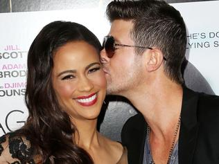 """LOS ANGELES, CA - SEPTEMBER 25: Actress Paula Patton (L) and recording artist Robin Thicke attend the premiere of Fox Searchlight Pictures' """"Baggage Claim"""" at the Regal Cinemas L.A. Live on September 25, 2013 in Los Angeles, California. (Photo by Frederick M. Brown/Getty Images)"""