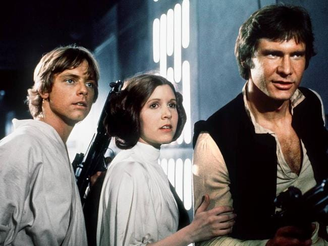 Feisty start ... Mark Hamill (Luke Skywalker), Carrie Fisher (Princess Leia) and Harrison Ford as (Han Solo) in Episode IV: A New Hope, where Leia was highly critical of Solo and Skywalker's attempts to rescue her.