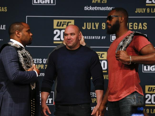 UFC president Dana White stands between Daniel Cormier (L) and Jon Jones.