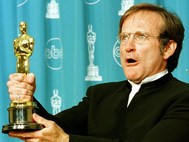 "Robin Williams holds Oscar he won for Best Supporting Actor in 1998 film ""Good Will Hunting"" at 1998 Academy Awards in Los Angeles. Picture: Afp"
