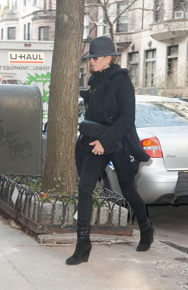 Jennifer Aniston goes out and about in NYC on 69th St and Central Park West.