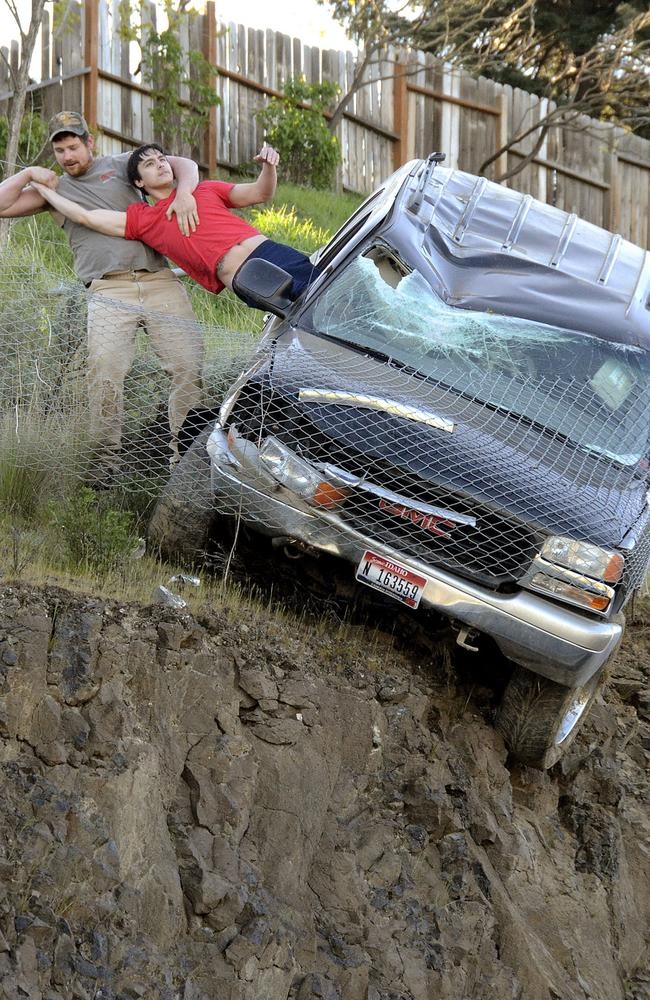 Lucky escape ... Mathew Sitko is pulled to safety by a mystery man. Picture: Barry Kough/Lewiston Tribune via AP.