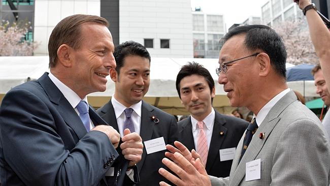 Networking ... Tony Abbott chats with Japanese Justice Minister Sadakazu Tanigaki at the embassy reception.