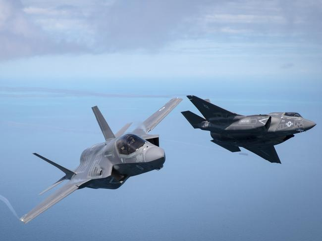 1: The first of Britain's new supersonic 'stealth' strike fighters accompanied by a United States Marine Corps F-35B. International customers are starting to realise how much Lockheed Martin is spying on them. Picture: Getty