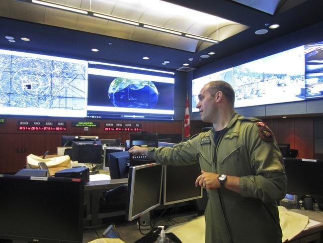 Royal Canadian Air Force Colonel Travis Morehen speaks in the North American Aerospace Defence Command command centre inside Cheyenne Mountain. Picture: AP/Dan Elliott
