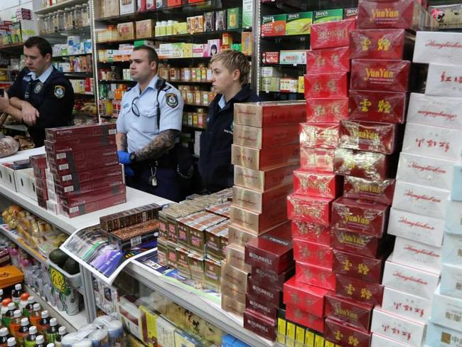 Police seize thousands of packets of illicit tobacco in Sydney's Campsie and Hurstville in August.
