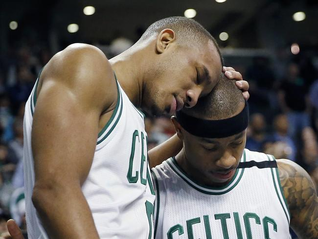 Boston Celtics' Avery Bradley (0) hugs teammate Isaiah Thomas (4). (AP Photo/Michael Dwyer)
