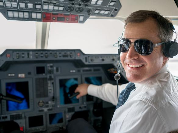 Handsome male pilot flying a private plane and wearing headset