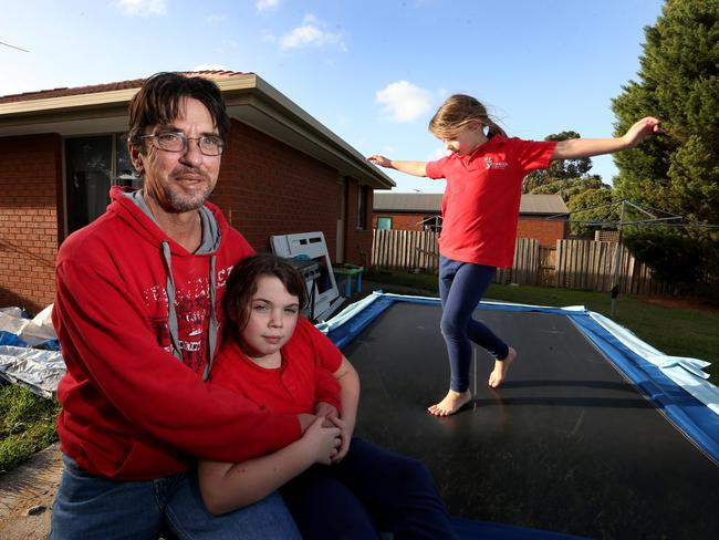 Duncan Storrar with his daughters Indica, 8 and Jakaylah-rose 6 at their home in Geelong, Victoria. Picture: David Geraghty/The Australian