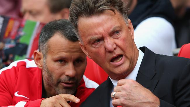 Manchester United Manager Louis van Gaal speaks with assistant Ryan Giggs during the loss to Swansea.
