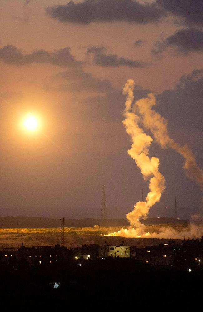 Night attack ... A photo taken from the southern Israeli Gaza border shows Israeli army flares falling into the Palestinian enclave.