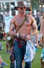 Shirtless Kellan Lutz shows off his new religious tattoos at Coachella. Picture: Splash News