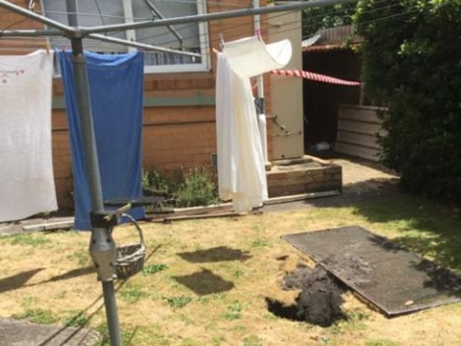 The sinkhole in the backyard. Picture: CFA