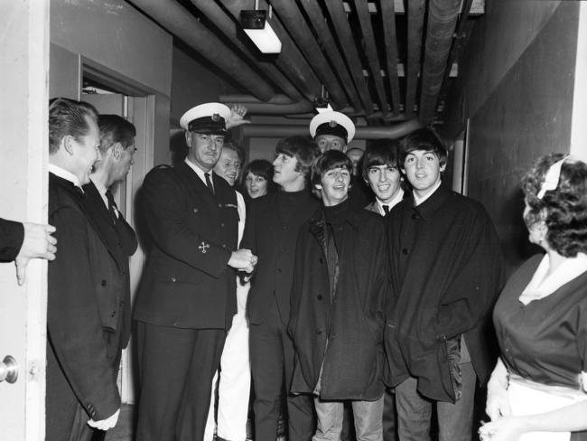 The Beatles with security and hotel staff at the Southern Cross Hotel. Picture: Laurie Richards/ Supplied