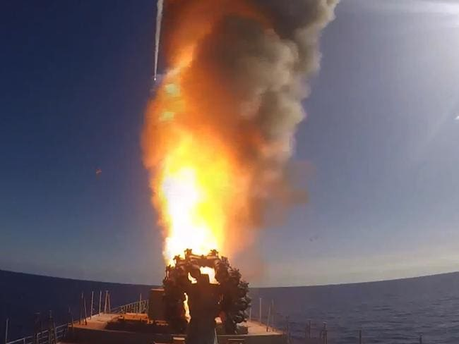 Frigate Admiral Grigorovich launching cruise missiles in the eastern Mediterranean off the Syrian coast during a strike from Russia against Islamic State (IS) group's positions in Syria. Picture: Russian Defence Ministry/AFP.