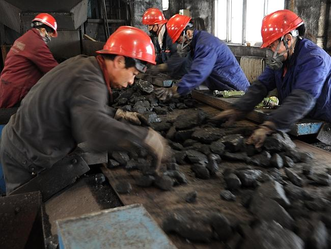 Health problems...Laborers work at a coal mining facility in Huaibei. Miners suffer lung problems risk death on the job, but say they earn far more than they could from farming. Picture: AFP