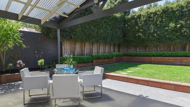 A rear courtyard and low-maintenance backyard are highlights.