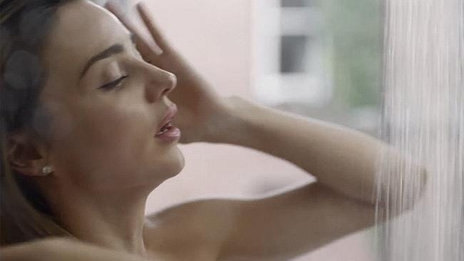 Miranda Kerr strips down to just a pair of black knickers for steamy shower scene in new Reebok advert.