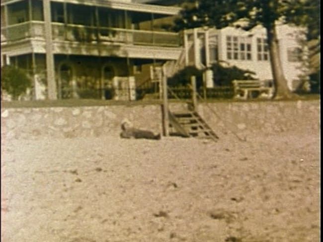 A reconstruction of the crime scene taken from a 1978 television documentary on the case. No photos exist of The Somerton Man's body in situ.