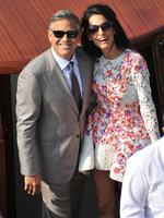 George Clooney and his wife Amal Alamuddin, cruise the Grand Canal after leaving the Aman luxury Hotel in Venice, Italy on Sunday, September 28th 2014. Picture: AP