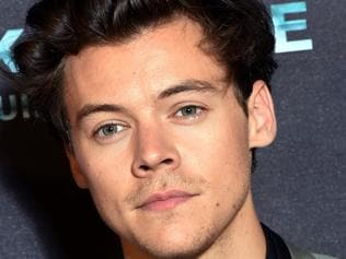 """British singer, songwriter and actor Harry Styles poses on July 16, 2017, during a photo-call at the cinema Ocine in Dunkirk, for the premier of the movie """"Dunkirk"""". The movie """"Dunkirk"""" will be released on July 19, 2017. / AFP PHOTO / FRANCOIS LO PRESTI"""