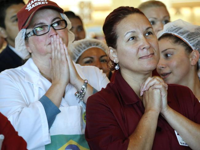 Overjoyed ... Market Basket employees Rosimeire Farias, left, and Luz Medina, right, clasp their hands as they watch a televised speech by restored Market Basket CEO Arthur T. Demoulas.
