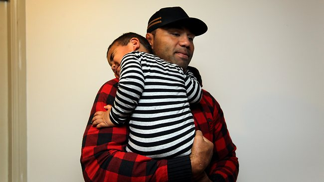 Wycliff Palu hugs son Muti, (who is still asleep), before leaving home. Picture: Mark Evans