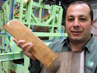 NEWS: Papyrus Australia managing director Ramy Azer with banana-based product. An airbag component for a Jaguar motor car that is going into production.