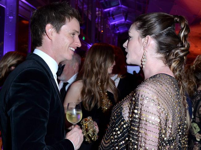 Actors Eddie Redmayne (L) and Anne Hathaway attend the 2016 Vanity Fair Oscar Party on February 28, 2016 in Beverly Hills, California. Picture: Jeff Vespa/VF16/WireImage