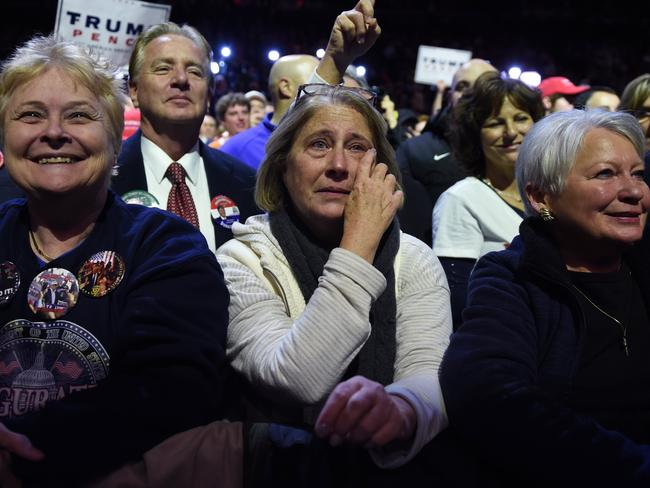 Supporters of Trump get emotional while he speaks at the rally in Ohio. Picture: Timothy A. Clary.