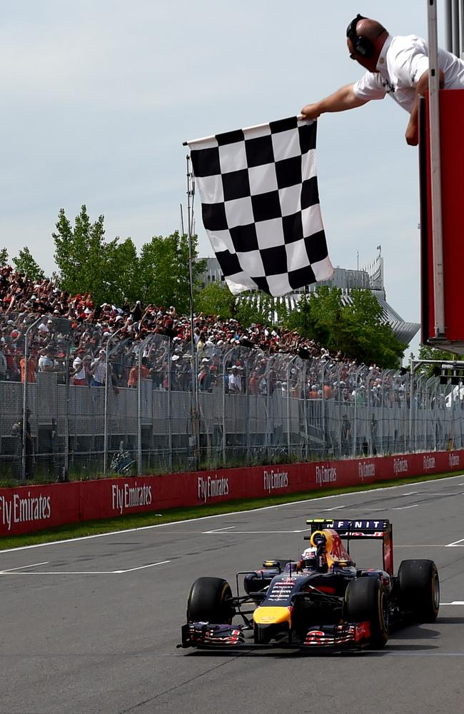 Red Bull driver Daniel Ricciardo takes the checkered flag as he wins the Canadian Formula One Grand Prix.
