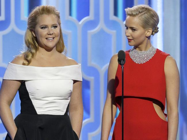 Amy Schumer and Jennifer Lawrence appear together onstage during the 73rd Annual Golden Globe Awards.