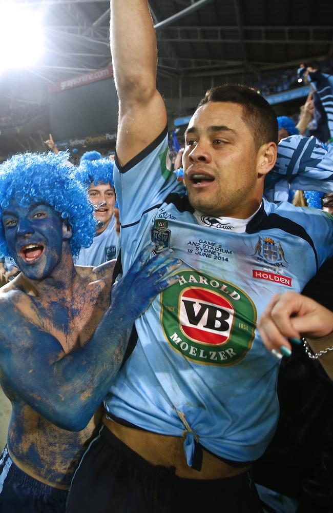 An emotional Jarryd Hayne is embraced by NSW fans after the State of Origin victory at ANZ Stadium, Sydney.