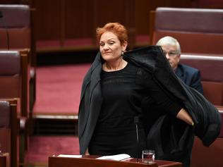One Nation Senator Pauline Hanson takes off a burqa during Senate Question Time at Parliament House in Canberra, Thursday, August 17, 2017. (AAP Image/Lukas Coch) NO ARCHIVING