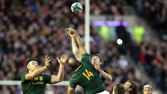 South Africa's JP Pietersen, centrr, and Marcell Coetzee, left, vie for the ball with Scotland's John Barclay at Murrayfield. Picture: Scott Heppell