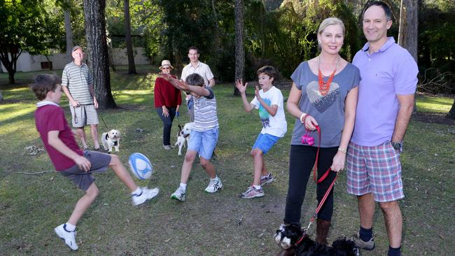 Liam Webb, Ben and Leo Mackie-Smith play footy at St Johns Wood while Ken and Lois McDonald, Ben Webb and Patricia and Andrew Mackie-Smith look on. Pic: Darren England