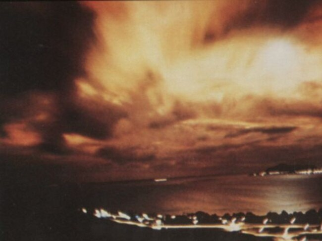 The night sky above Honolulu is lit with an eerie glow after the Starfish Prime high-altitude thermonuclear test.