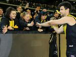 Trent Cotchin celebrates with fans after the win. Picture: Mark Stewart