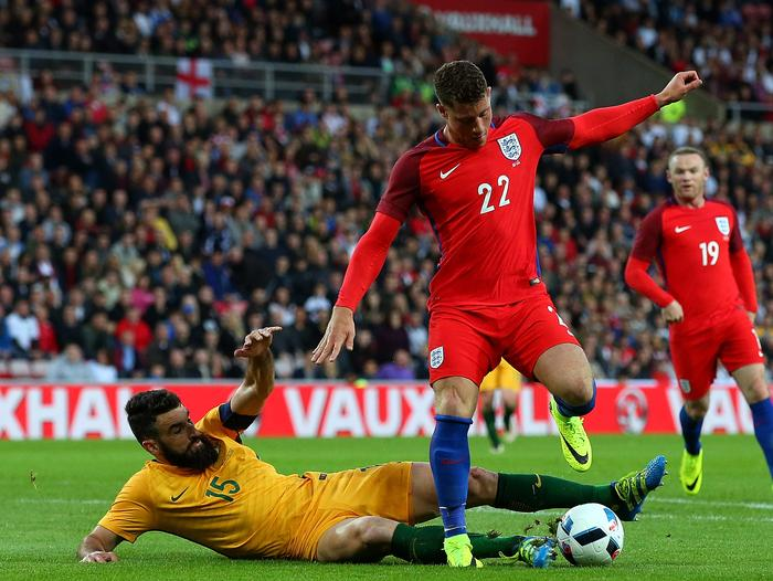 Ross Barkley is tackled by Mile Jedinak.