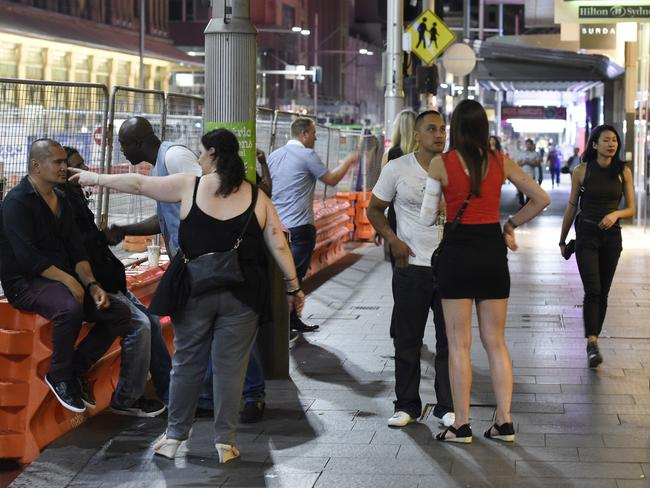 Concertgoers fled the fight into George Street. Picture: Gordon McComiskie